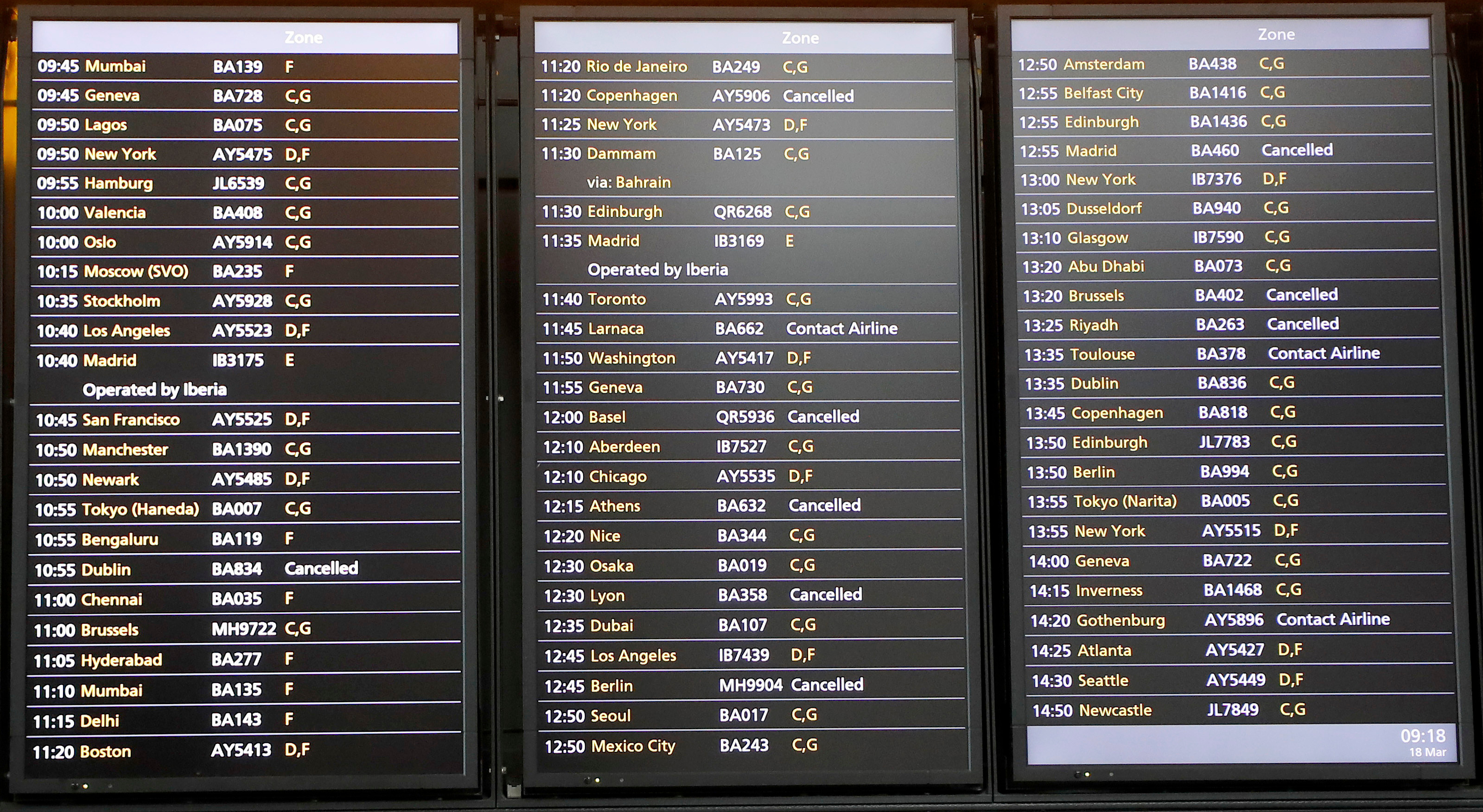 The flight schedule board shows a few cancelled flights at Heathrow Airport in London on Wednesday