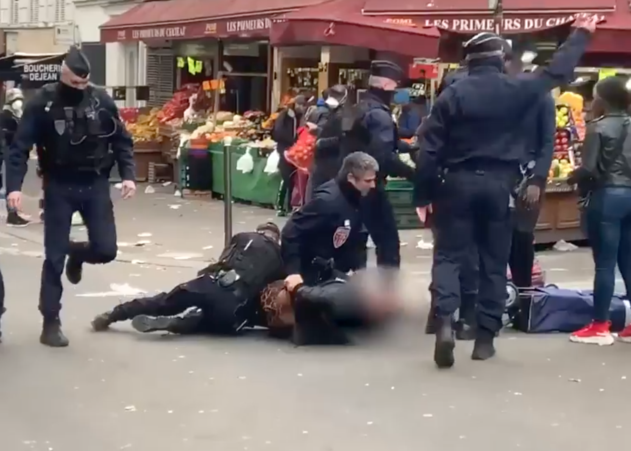 Earlier in the week police were pictured restraining a woman in a Paris street