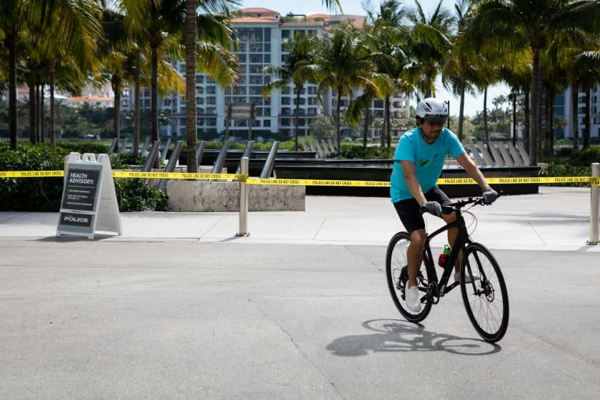 A man rides his bike in Miami Beach, Fla.