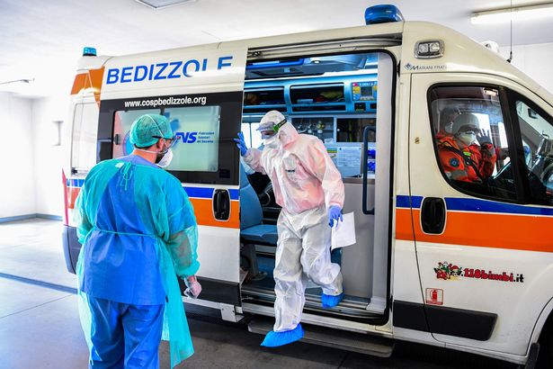 Medical workers outside an intensive care unit of the Brescia Poliambulanza hospital, Lombardy