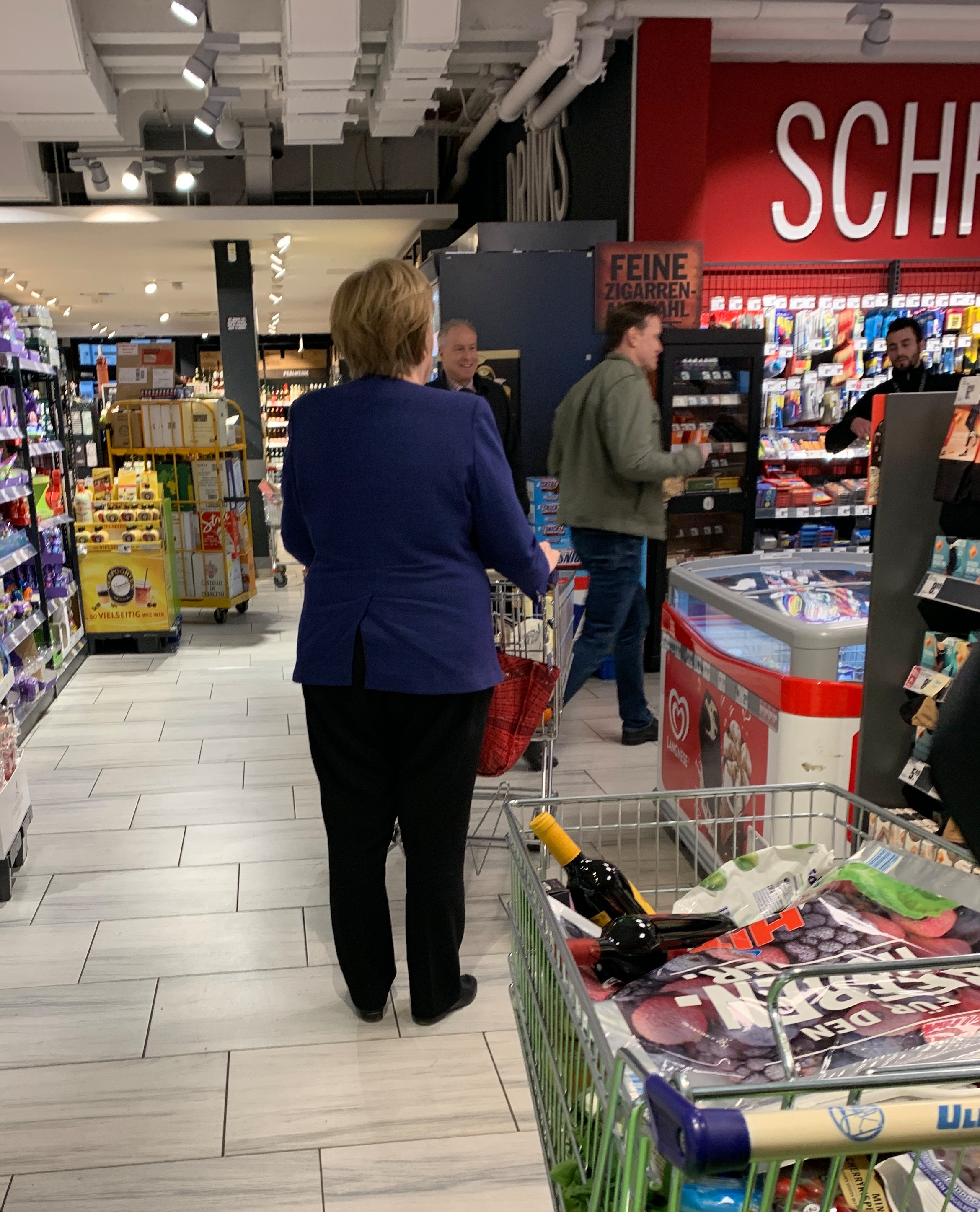 Ms Merkel spent about half an hour getting good before checking out from the supermarket in Berlin