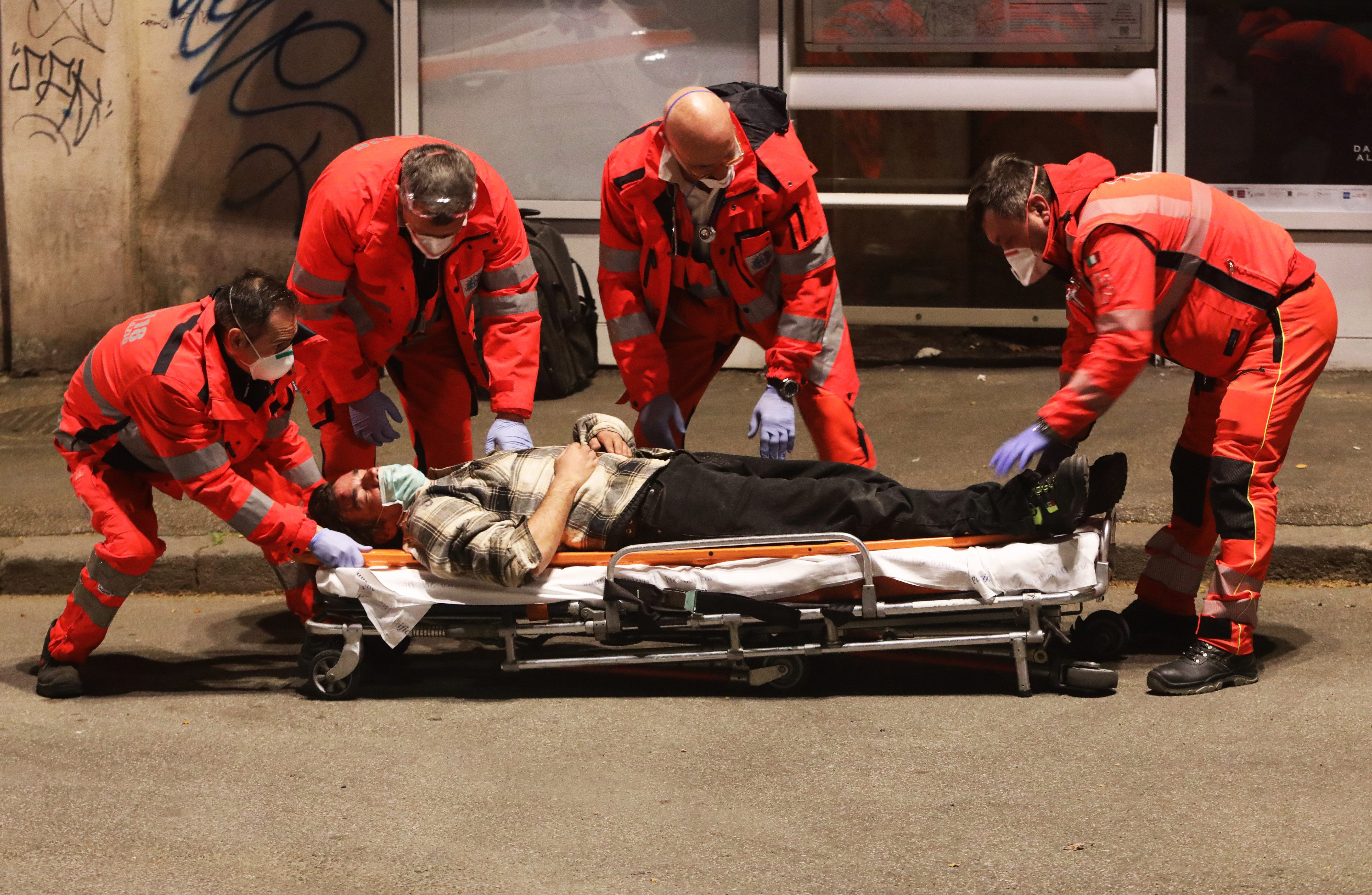 The man is seen being loaded onto a stretcher in Rome