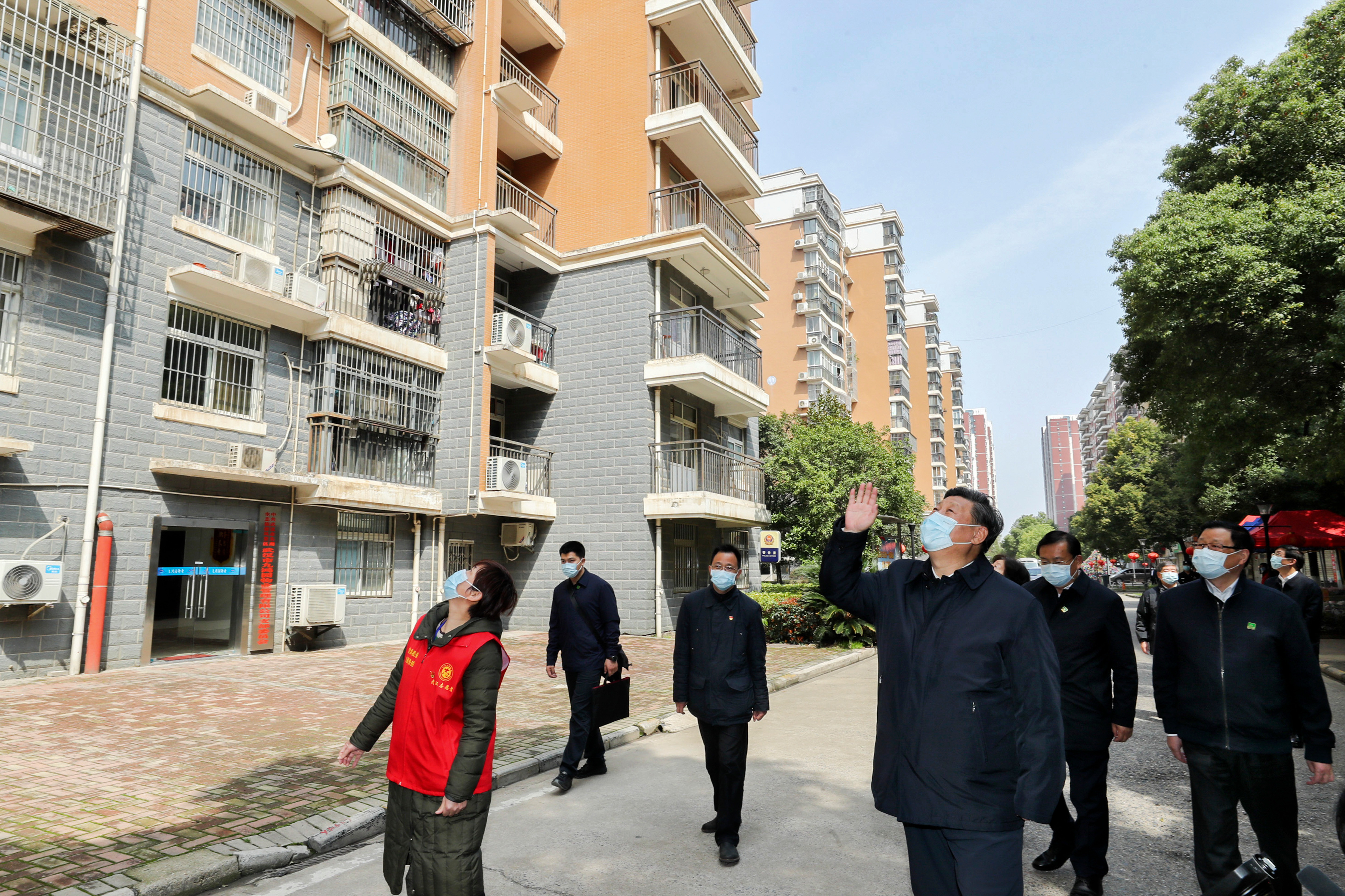 President Xi Jinping waves to residents in quarantine during his visit to Wuhan earlier this month