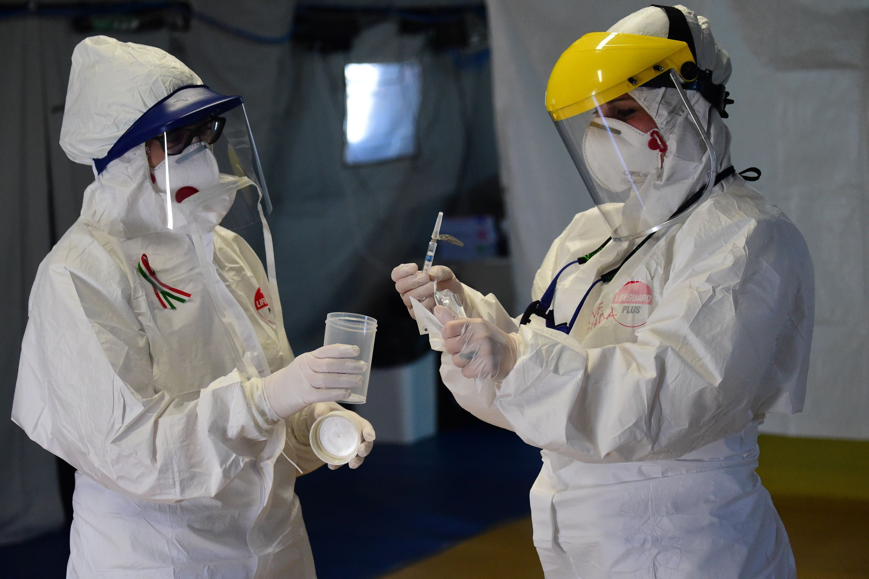 Healthcare workers check samples for further testing in Bologna, Italy