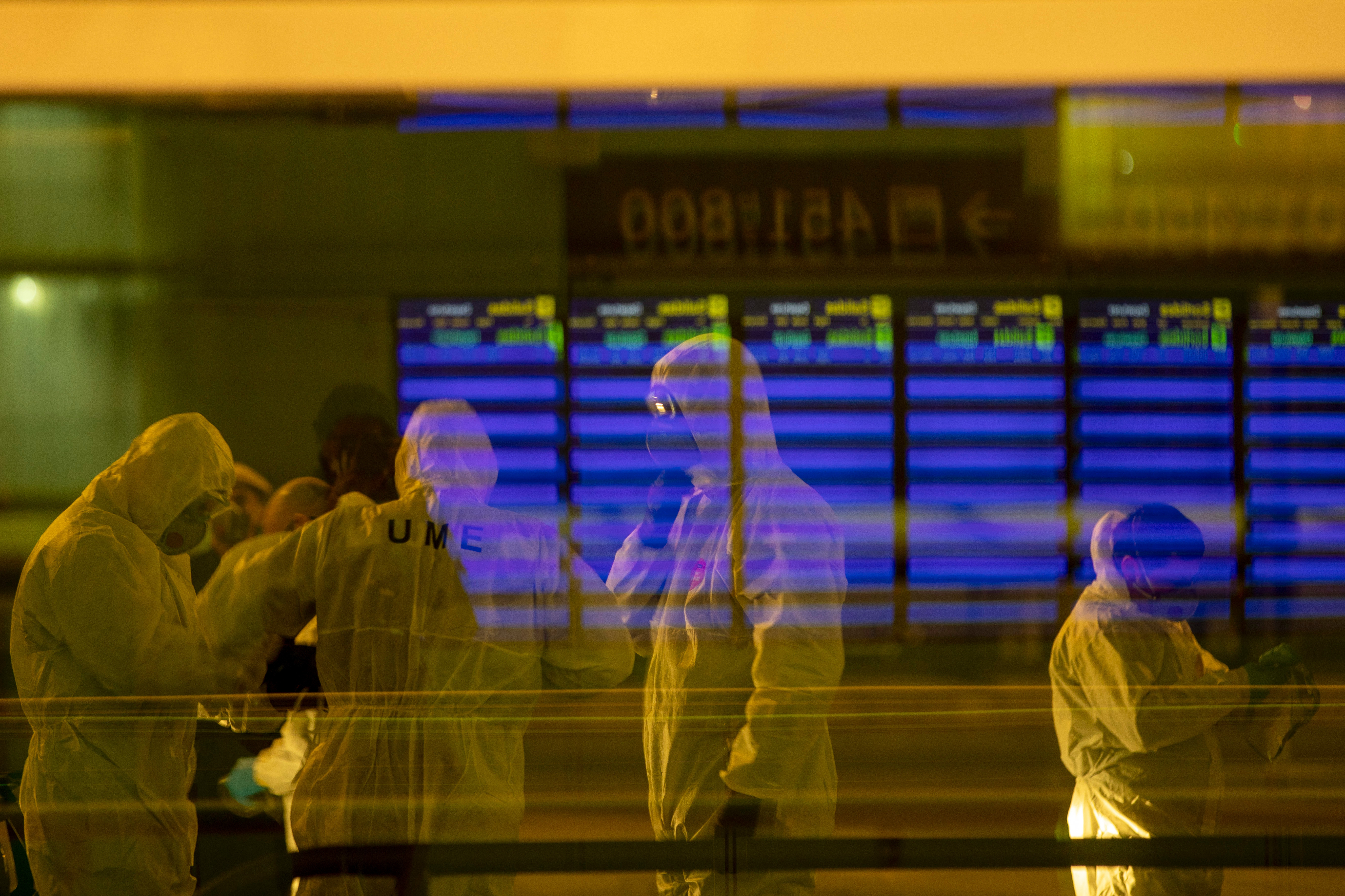 Spanish UME (Emergency Army Unit) soldiers disinfect a terminal to prevent the spread of the new coronavirus at a Barcelona airport