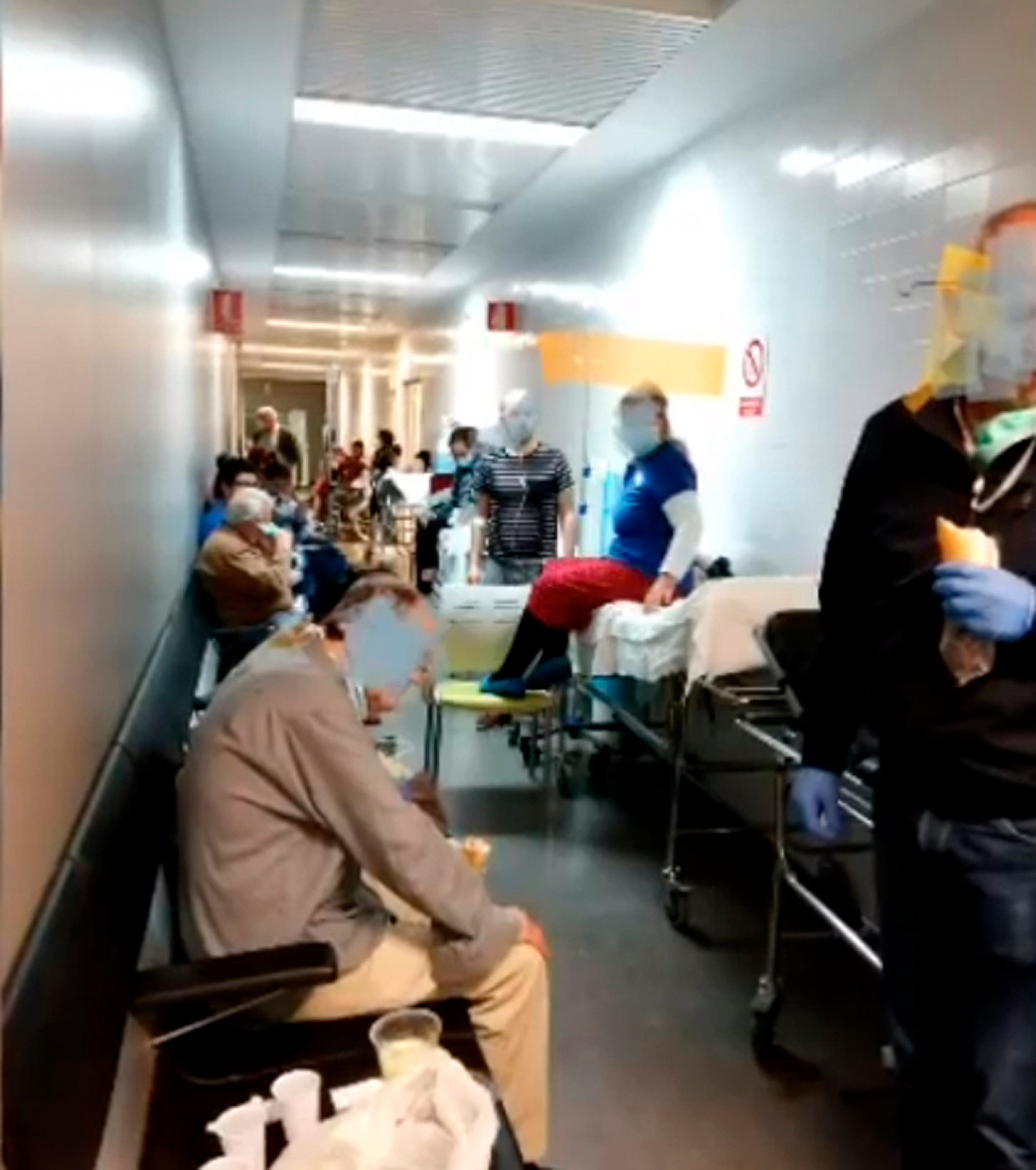 Patients in the corridor of the hospital of Albacete. It has been reported that there is a three day wait for a bed in the country
