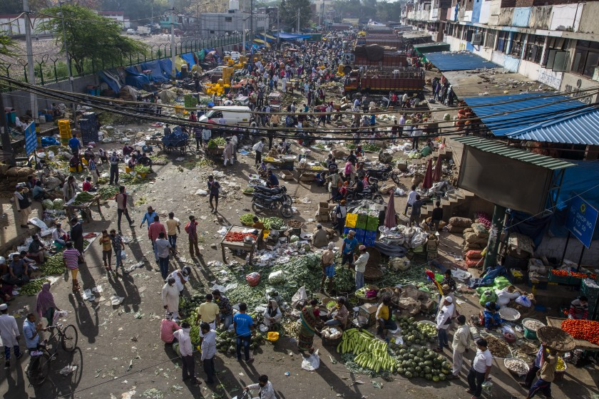 Indian shopkeepers and customers jammed a marketplace in New Delhi a day after a nationwide lockdown.
