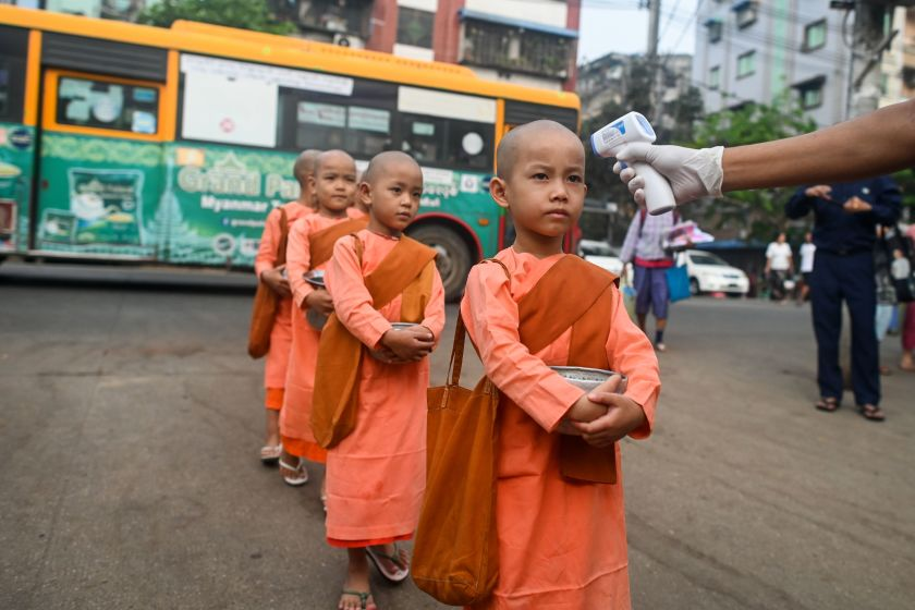 Young Buddhist nuns line up to have their temperature taken by authorities in Yangon, Myanmar.