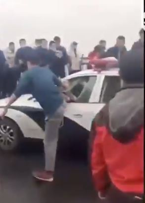 Angry mobs attacked police near China's coronavirus epicentre Wuhan on Friday