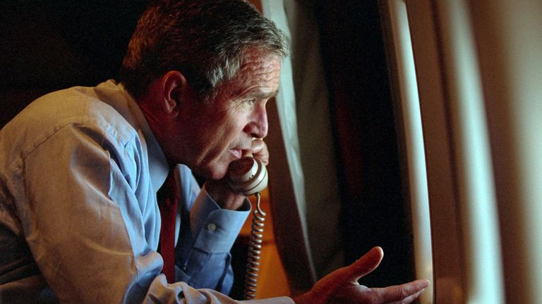 """U.S. President George W. Bush speaks to Vice President Dick Cheney by phone aboard Air Force One after departing Offutt Air Force Base in Nebraska, September 11, 2001, on the day of the terror attacks in New York and Washington. Bush on September 16, 2001 asked """"horrified"""" Americans to go back to work this week, cautioning them to be alert for more attacks and to brace for a long crusade to """"rid the world of evildoers"""". Picture released by the White House on September 16. REUTERS/WHITE HOUSE photo by Eric Draper  ME"""