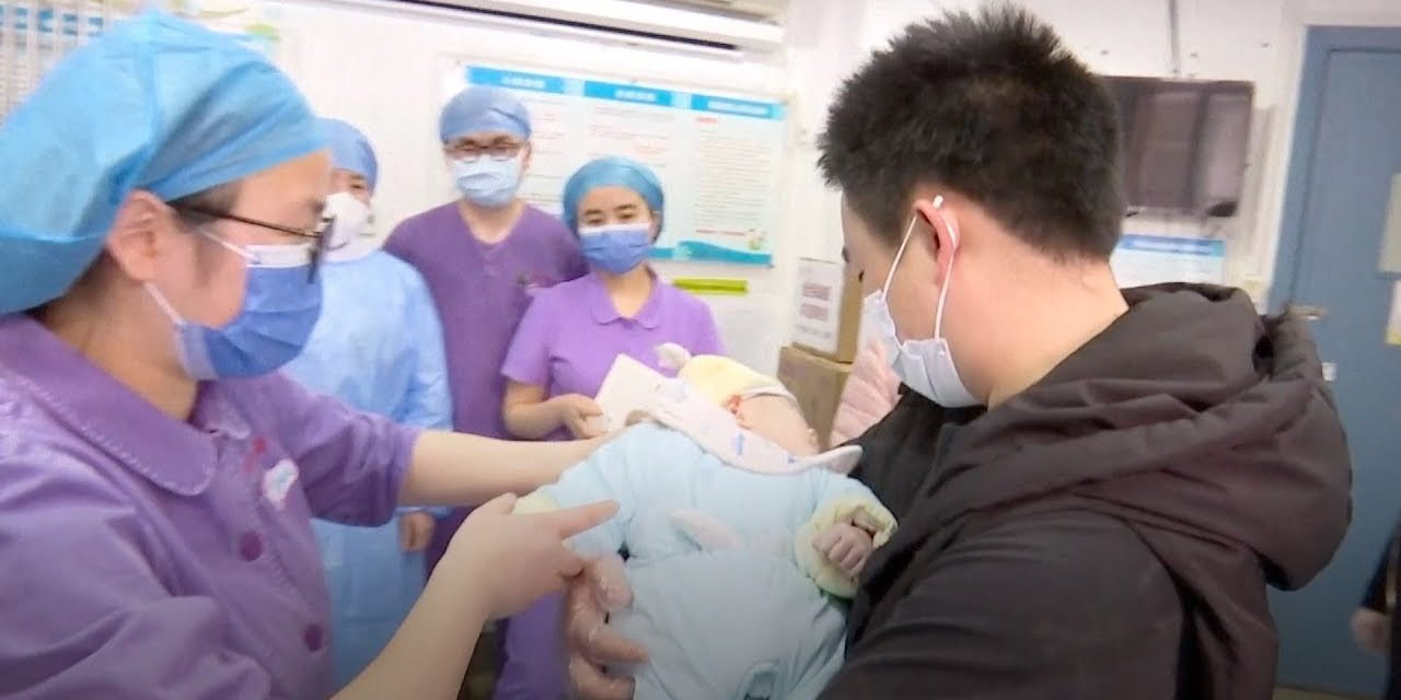 COVID-19-infected parents and newborn baby reunite after weeks apart