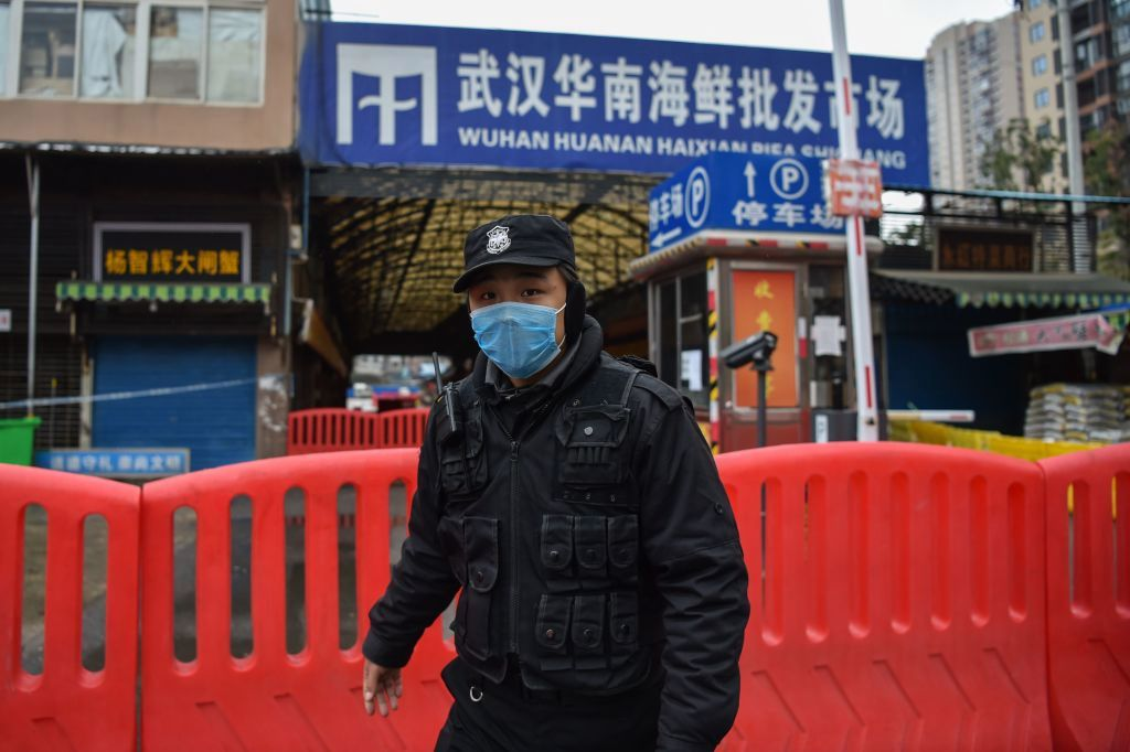 A police officer stands guard outside of Huanan Seafood Wholesale market where coronavirus started