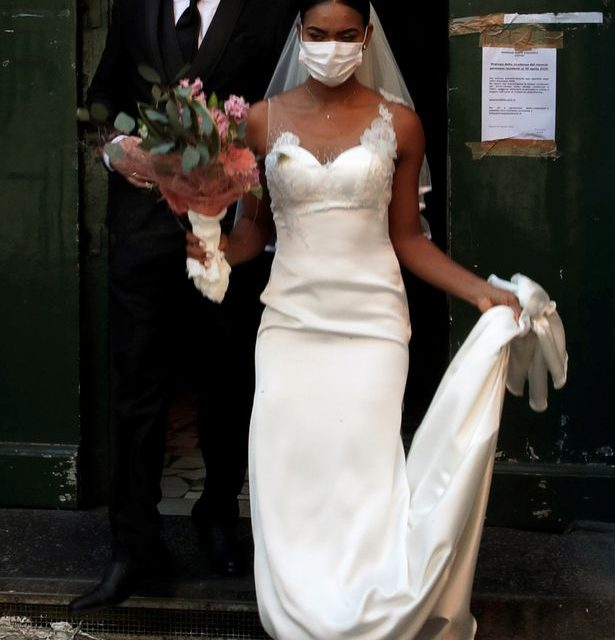 Coronavirus: Italian newlyweds kiss through face masks as country's death toll tops 4,000 – World News