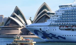 The Ruby Princess cruise ship departs Sydney Harbour with no passengers and only crew on board as it passes the Opera House sails on 19 March, 2020 in Sydney, Australia.