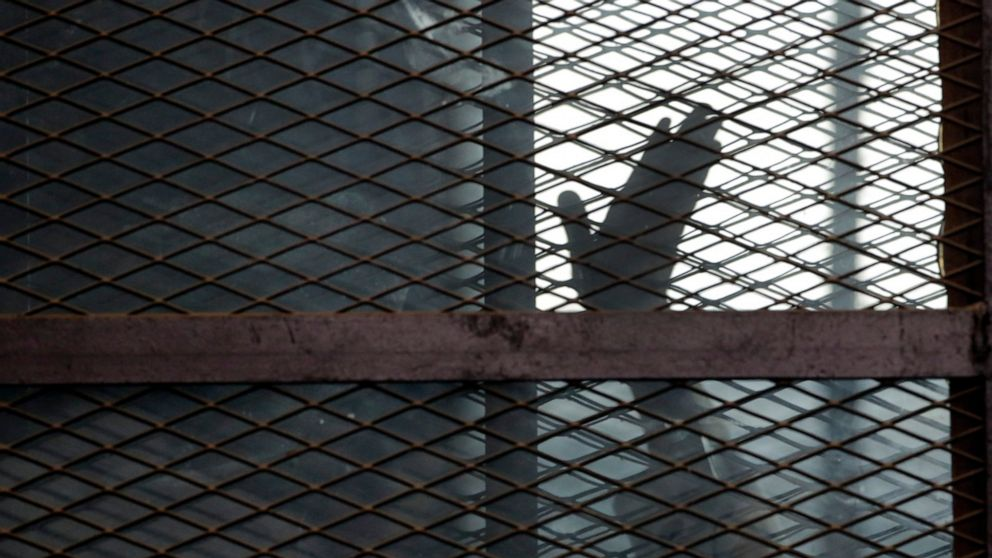 Crammed in filthy cells, political prisoners fear infection
