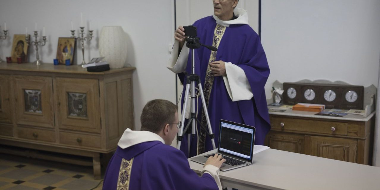 During virus, priests master livestream at Gothic cathedral