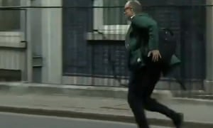 Chief Adviser Dominic Cummings runs out of Downing Street shortly after Johnson announced he tested positive for Covid-19.