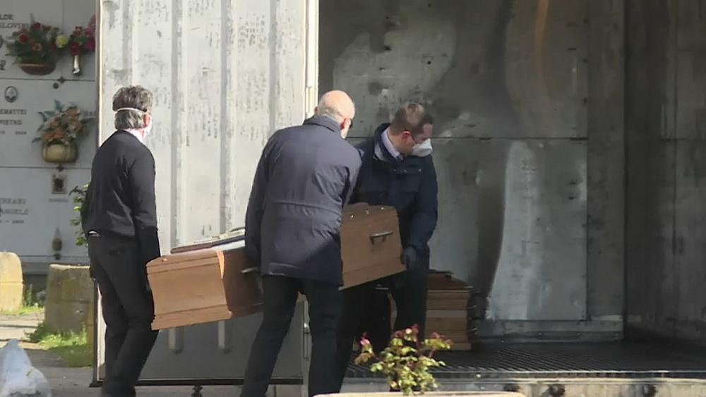 Parts of Italy struggle to cope with the sheer volume of COVID-19 deaths
