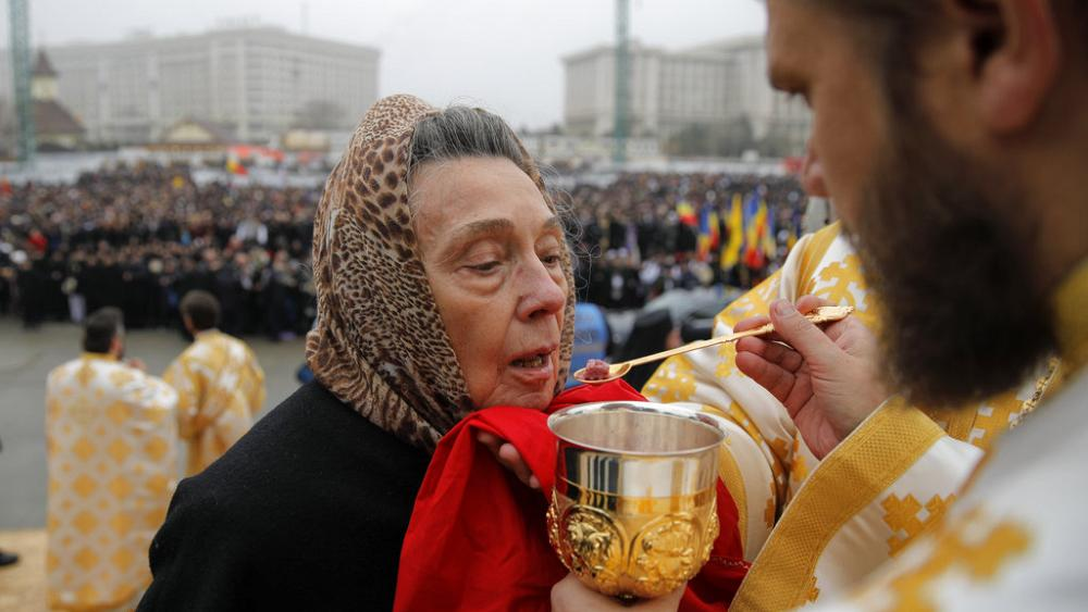 Priests give communion with shared spoon as Romania COVID-19 cases grow