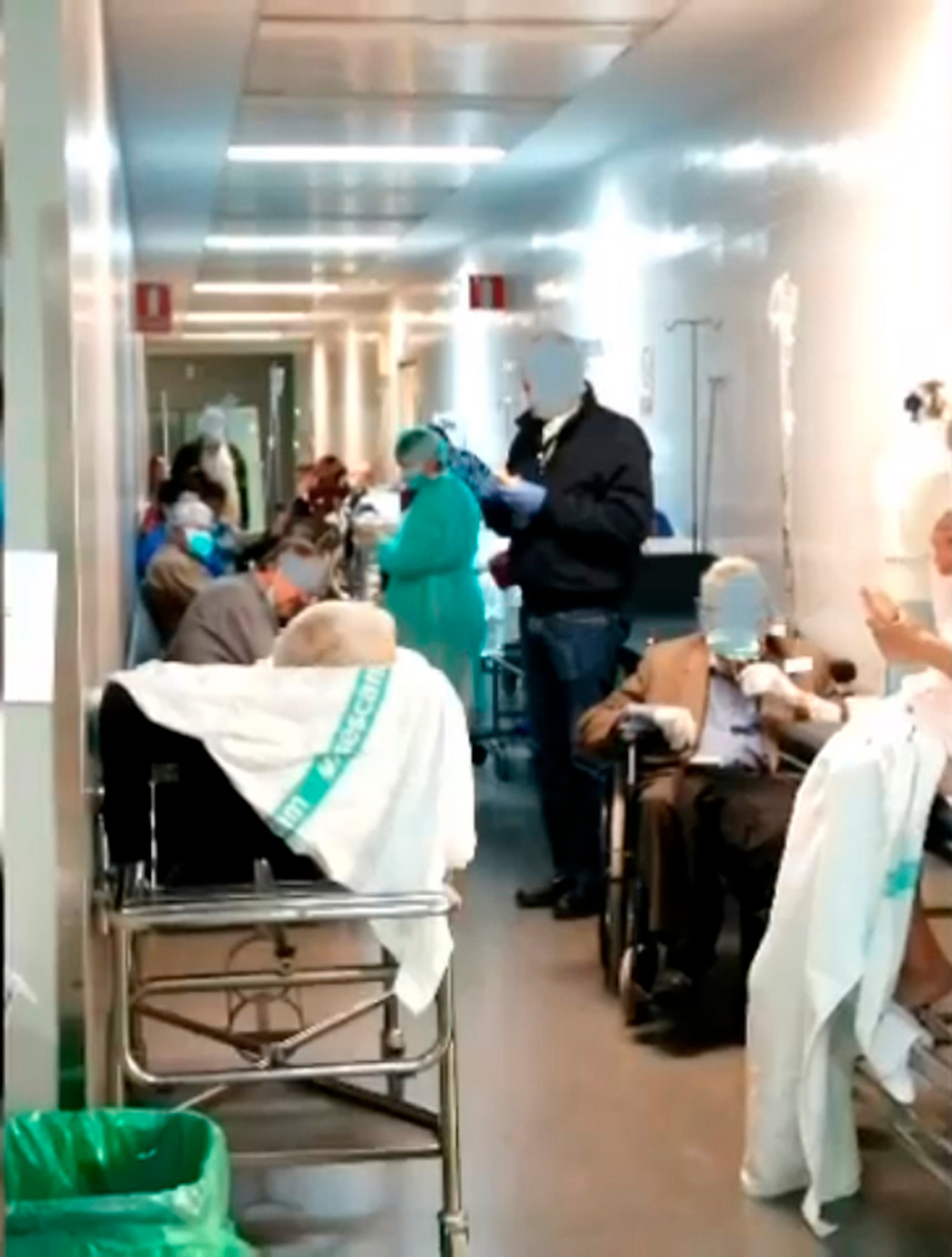Coronavirus patients in Spain are filmed huddled in a corridor as the country's hospitals struggle to cope with the pandemic