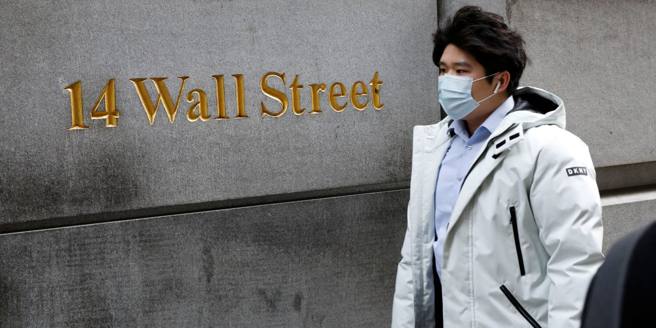 Stock futures fall, point to another volatile week