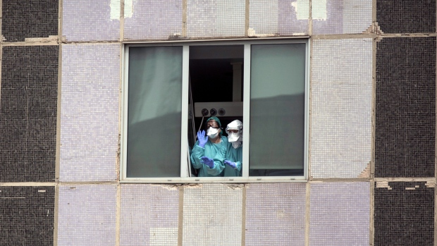 'We are collapsing': Virus pummels medics in Spain and Italy