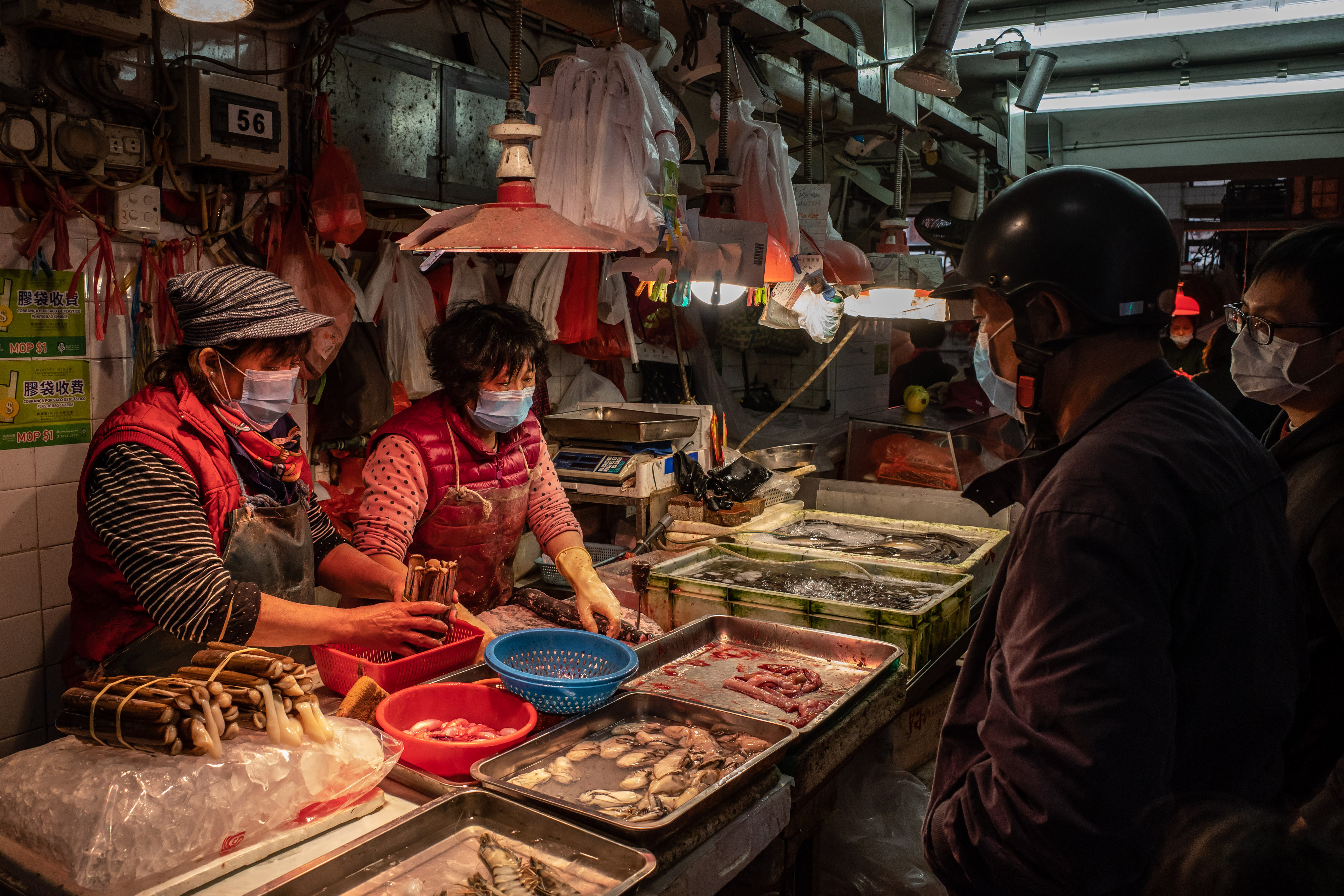 Residents wearing face masks buy seafood at a wet market on January 28, 2020 in Macau, China